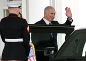 Israeli Prime Minister Benjamin Netanyahu waves as he leaves the west wing of the White House following a meeting with US President Barack Obama...