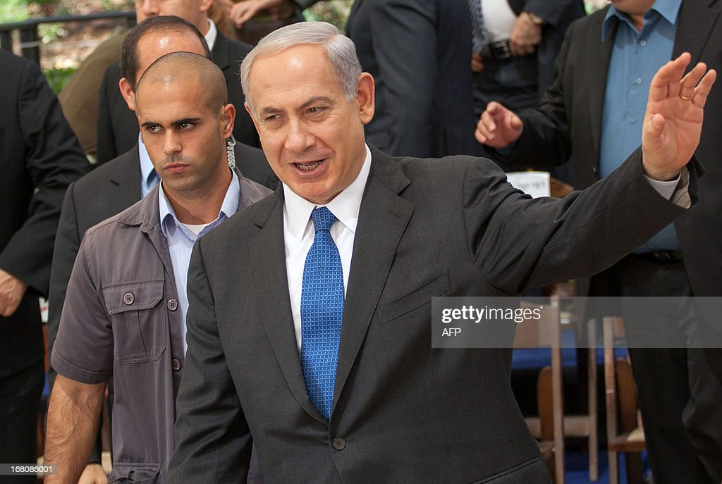 Israeli Prime Minister Benjamin Netanyahu waves during the weekly cabinet meeting at the Herzl Museum in Jerusalem on May 5, 2013. Israel carried out a pre-dawn air strike near Damascus, targeting Iranian missiles destined for Lebanon's Hezbollah in the second such raid on Syrian soil in three days, a senior Israeli source said. AFP PHOTO/POOL/EMIL SALMAN