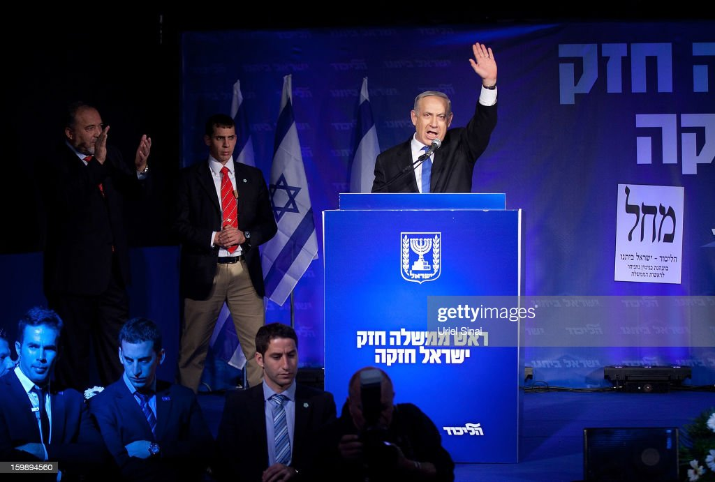 Israeli Prime Minister <a gi-track='captionPersonalityLinkClicked' href=/galleries/search?phrase=Benjamin+Netanyahu&family=editorial&specificpeople=118594 ng-click='$event.stopPropagation()'>Benjamin Netanyahu</a> waves to his supporters as he arrives with Former Israel Minister for Foreign Affairs Avigdor Liberman at his election campaign headquarters on Janurary 23, 2013 in Tel Aviv, Israel. Exit polls suggested that current Prime Minister <a gi-track='captionPersonalityLinkClicked' href=/galleries/search?phrase=Benjamin+Netanyahu&family=editorial&specificpeople=118594 ng-click='$event.stopPropagation()'>Benjamin Netanyahu</a> will return to office, although he performed worse than expected.