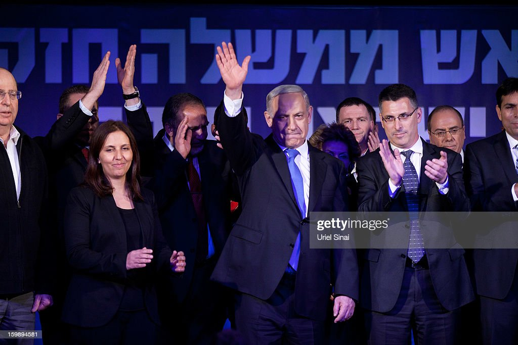 Israeli Prime Minister Benjamin Netanyahu waves to his supporters at his election campaign headquarters on Janurary 23, 2013 in Tel Aviv, Israel. Exit polls suggested that current Prime Minister Benjamin Netanyahu will return to office, although he performed worse than expected.