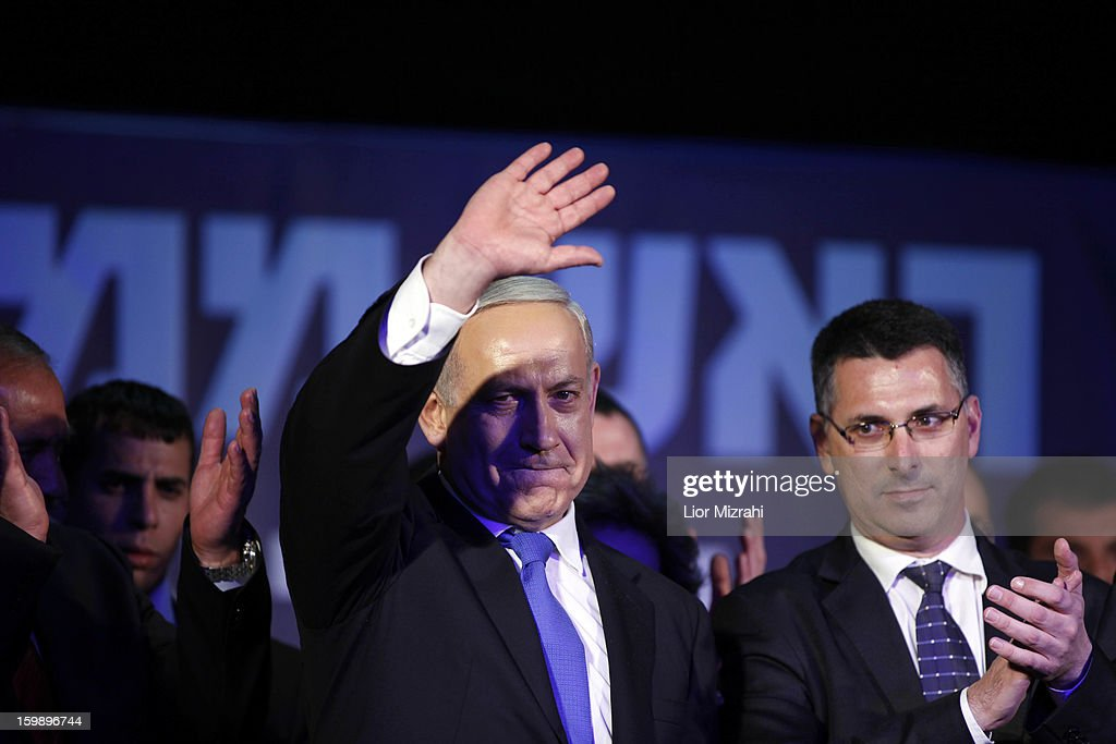 Israeli Prime Minister <a gi-track='captionPersonalityLinkClicked' href=/galleries/search?phrase=Benjamin+Netanyahu&family=editorial&specificpeople=118594 ng-click='$event.stopPropagation()'>Benjamin Netanyahu</a> waves to supporters at his election campaign headquarters on Janurary 23, 2013 in Tel Aviv, Israel. Netanyahu was re-elected for a third term and will return to office, according to exit polls. Israel had the highest turnout of voters since 1999.