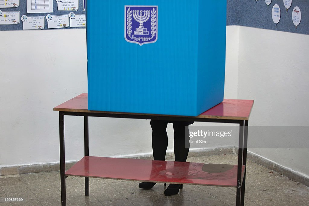 Israeli Prime Minister Benjamin Netanyahu's wife <a gi-track='captionPersonalityLinkClicked' href=/galleries/search?phrase=Sara+Netanyahu&family=editorial&specificpeople=1061079 ng-click='$event.stopPropagation()'>Sara Netanyahu</a> casts her ballot at a polling station on election day on January 22, 2013 in Jerusalem, Israel. Israel's general election voting has begun today as polls show Netanyahu is expected to return to office with a narrow majority.