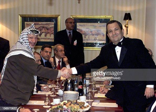 Israeli Prime Minister Ehud Barak and Palestinian Authority President Yasser Arafat shake hands at the begining of a meeting between the two sides'...