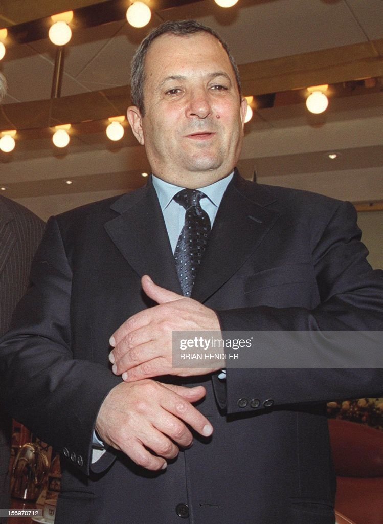 Israeli Prime Minister Ehud Barak attends a meeting with members of the US Senate Intelligence Committee in his Jerusalem office 15 March 2000 after...