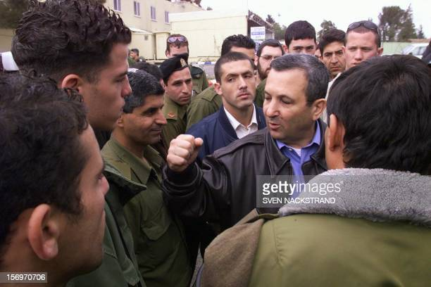 Israeli Prime Minister Ehud Barak speaks to soldiers as he visits the northern border and Metulla 01 February 2000 Barak also paid a condolences...