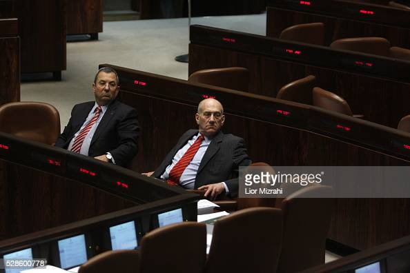 Israeli Prime Minister Ehud Olmert and Defence Minister Ehud Barak are seen during a session of the Knesset on March 30 2009 in Jerusalem Israel