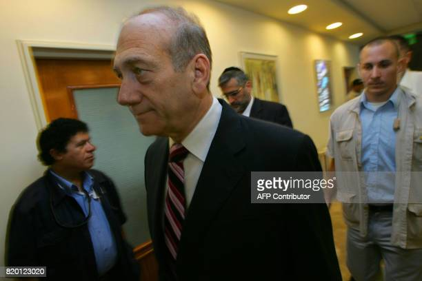 Israeli Prime Minister Ehud Olmert arrives for the weekly cabinet meeting 06 August 2006 in Jerusalem After more than 3 weeks of fighting Hezbollah...