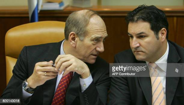 israeli Prime Minister Ehud Olmert confers with Cabinet Secretary Yisrael Maimon at the start of the weekly cabinet meeting 30 May 2006 in Jerusalem...