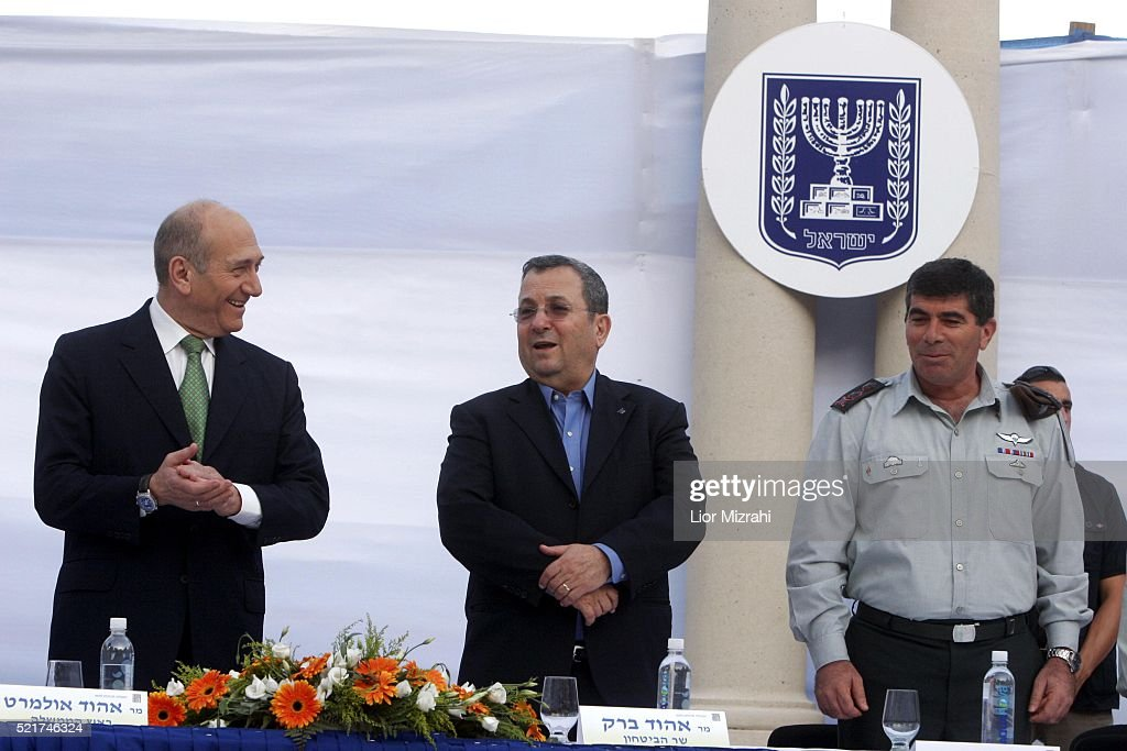 Israeli Prime Minister Ehud Olmert Defence Minister Ehud Barak and Chief of Staff Lt Gen Gabi Ashkenazi are seen during a ceremony on July 31 2007 in...