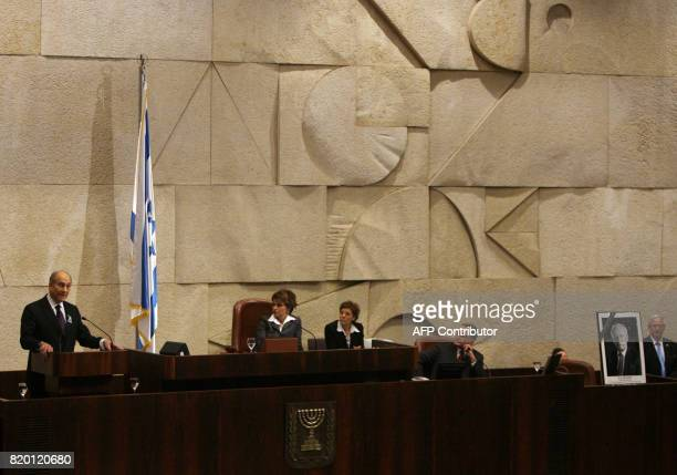 Israeli Prime Minister Ehud Olmert delivers a speech in the Knesset in Jerusalem where a memorial session marking the 11th anniversary of the...