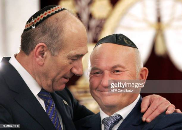 Israeli Prime Minister Ehud Olmert hugs Moscow Mayor Yuri Luzhkov as they attend the 100th anniversary celebration of Moscows Great Synagogue 18...