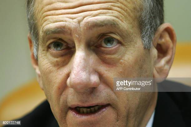 Israeli Prime Minister Ehud Olmert makes a statement at the start of the weekly cabinet meeting 06 August 2006 in Jerusalem After more than 3 weeks...