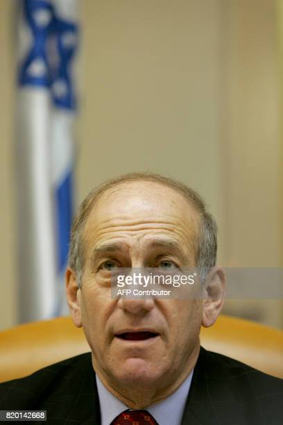 Israeli Prime Minister Ehud Olmert makes his opening remarks at the start of the weekly cabinet meeting 30 May 2006 in Jerusalem The Israeli army...