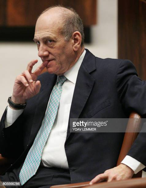 Israeli Prime Minister Ehud Olmert sits during an Israeli Parliament session 17 January 2007 Israel's military chief of Staff Dan Halutz quit early...