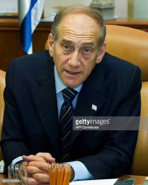 Israeli Prime Minister Ehud Olmert speaks as he sits opposit his Defense Minister Amir Peretz as he chairs the weekly cabinet meeting in his...