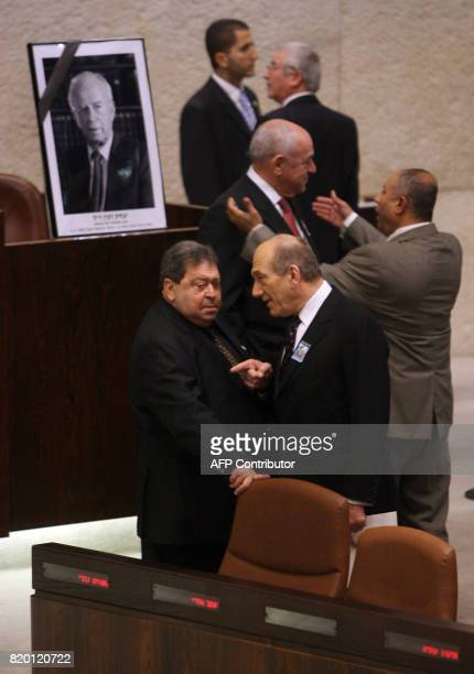 Israeli Prime Minister Ehud Olmert speaks with his Minister of National Infastructure Binyamin BenEliezer as the Knesset in Jerusalem holds a special...