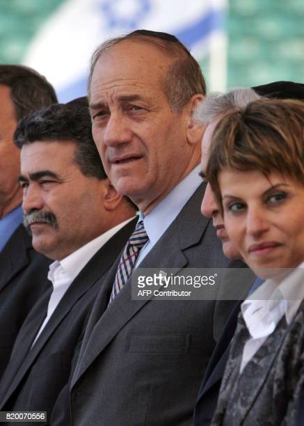 Israeli Prime Minister Ehud Olmert stands with Deputy Premier Amir Peretz and Speaker of the House Dalia Itzik at the tomb of Theodor Herzl on Mt...