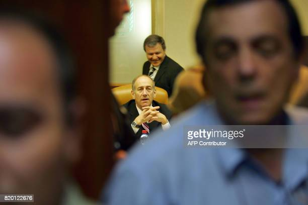 Israeli Prime Minister Ehud Olmert waits for the media to leave at the start of the weekly cabinet meeting 06 August 2006 in Jerusalem After more...