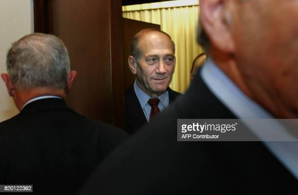 Israeli Prime Minister Ehud Olmert walks into a meeting with American billionaire Warren Buffett at his Jerusalem office 18 September 2006 Buffett...