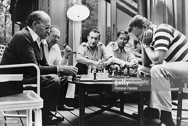 Israeli Prime Minister Menachem Begin and American National Security Advisor Zbigniew Brzezinski play a game of chess at the Camp David Summit...