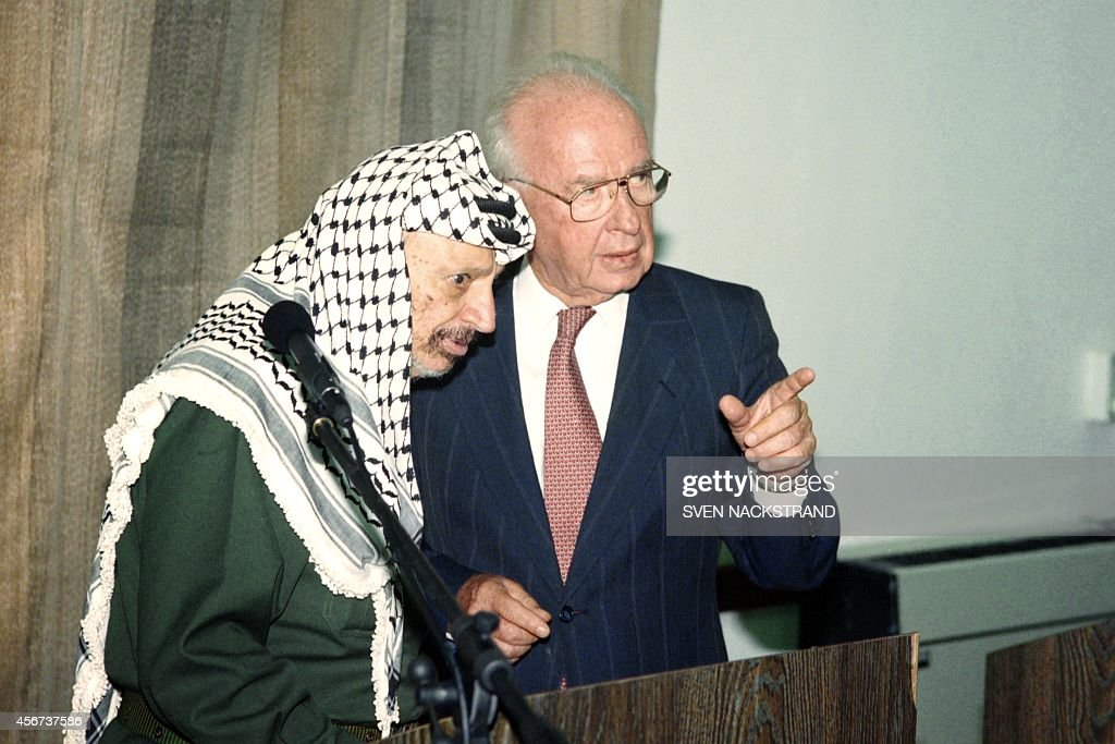 Israeli Prime Minister <a gi-track='captionPersonalityLinkClicked' href=/galleries/search?phrase=Yitzhak+Rabin&family=editorial&specificpeople=94269 ng-click='$event.stopPropagation()'>Yitzhak Rabin</a> (R) speaks to PLO Chairman <a gi-track='captionPersonalityLinkClicked' href=/galleries/search?phrase=Yasser+Arafat+-+Politiek+leider&family=editorial&specificpeople=118625 ng-click='$event.stopPropagation()'>Yasser Arafat</a> (L) on September 25, 1994 during their meeting at Erez checkpoint. Rabin and Arafat agreed to launch negotiations a week on the next stage of Autonomy, including army redeployment and elections.