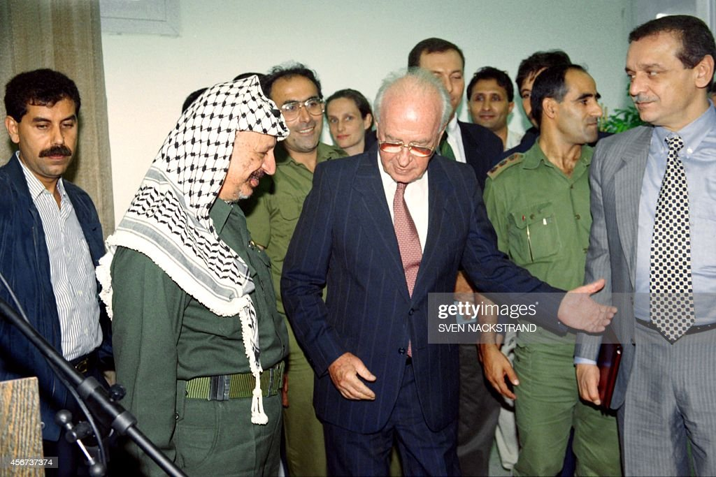 Israeli Prime Minister <a gi-track='captionPersonalityLinkClicked' href=/galleries/search?phrase=Yitzhak+Rabin&family=editorial&specificpeople=94269 ng-click='$event.stopPropagation()'>Yitzhak Rabin</a> welcomes PLO Chairman <a gi-track='captionPersonalityLinkClicked' href=/galleries/search?phrase=Yasser+Arafat+-+Politiek+leider&family=editorial&specificpeople=118625 ng-click='$event.stopPropagation()'>Yasser Arafat</a> (L) on September 25, 1994 during their meeting at Erez checkpoint. Rabin and Arafat agreed to launch negotiations a week on the next stage of Autonomy, including army redeployment and elections.