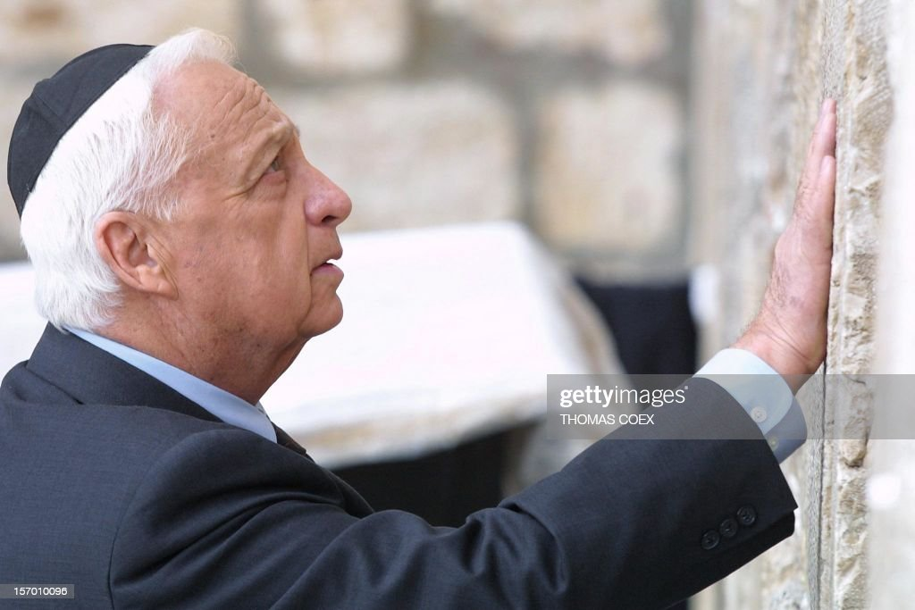 Israeli Prime Ministerelect Ariel Sharon places his hand on the Western Wall Judaism's holiest site in the Old City of Jerusalem 07 February 2001 It...