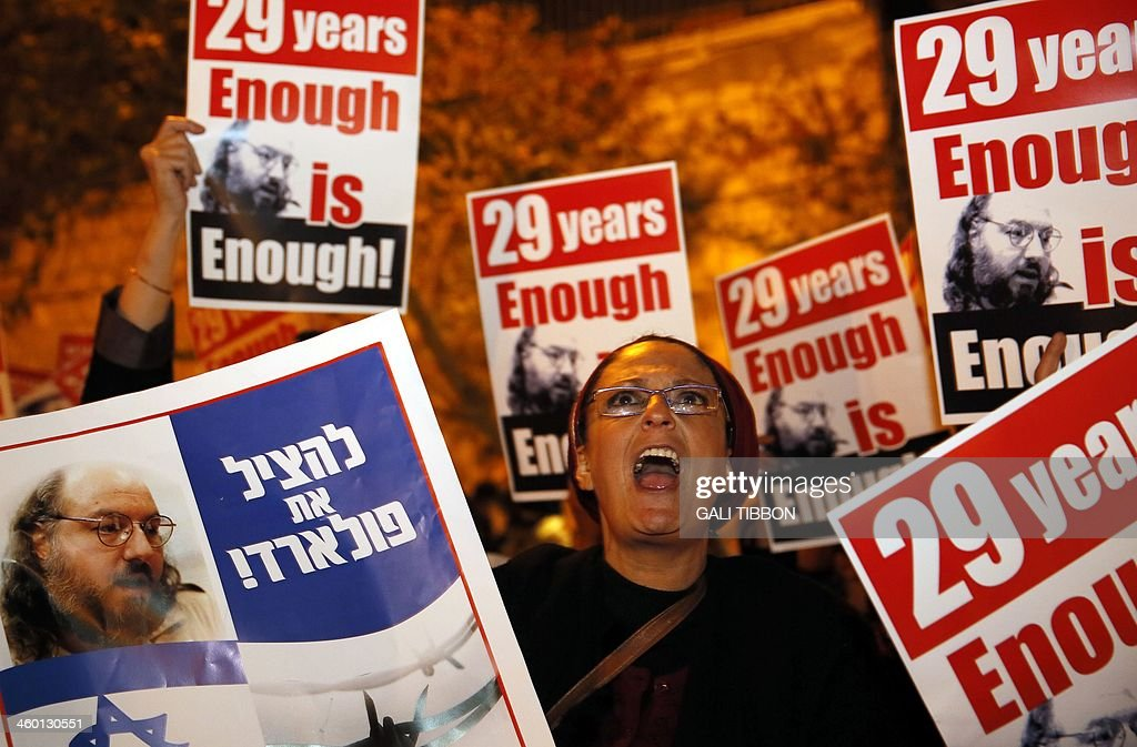 Israeli protesters hold placards as they call for the release of Jonathan Pollard, a Jewish American who was arrested in 1985 for giving Israel thousands of secret documents about US espionage in the Arab world, during a protest in Jerusalem on January 2, 2014, outside the hotel where the US Secretary of State is staying during his four-day visit. Pollard is a convicted Israeli spy and a former US Naval civilian intelligence analyst who received a life sentence in the mid 1980s. Israeli MPs handed President Shimon Peres a petition on January 1 urging the United States to release imprisoned Israeli spy Jonathan Pollard, after reports Washington spied on its own allies.