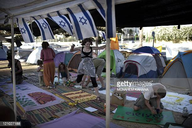 Israeli protestors prepare antigovernment posters at their protest tent camp before the evening's demonstration in the southern Israeli city of...