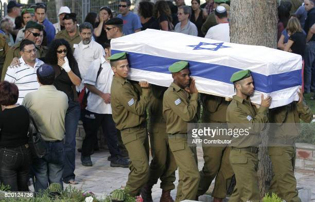Israeli relatives comfort each other as the coffin of Sgt Nimrod Cohen 19yearsold killed in southern Lebanon yesterday during a military operation to...