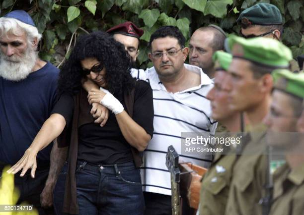 Israeli relatives comfort each other during the funeral of Sgt Nimrod Cohen 19yearsold killed in southern Lebanon yesterday during a military...