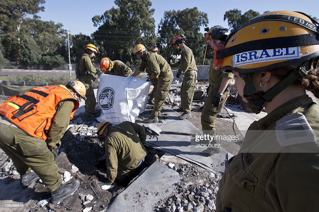 Israeli rescue troops of the home front command take part in a simulation of evacuating casualties from a collapsed school building in the city of Holon, south of Tel Aviv, on December 18, 2012.
