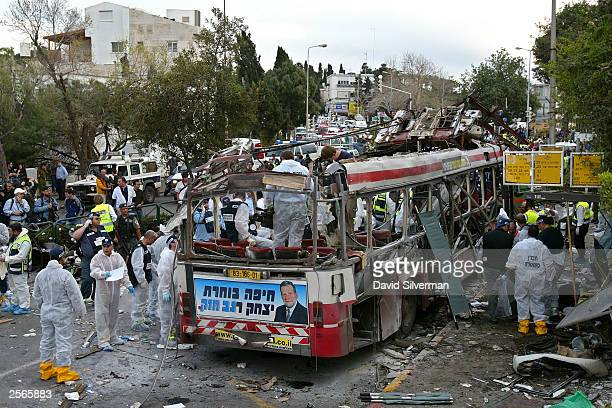 Israeli rescue workers and police search for evidence and victims at the scene of a Palestinian suicide bombing on an Israeli bus March 5 2003 in the...