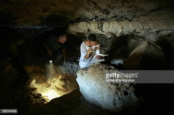 Israeli researcher from the Israeli Cave Research Center search in a cave in Nahal Arugot near the Dead Sea in the West Bank 05 May 2005 after two...
