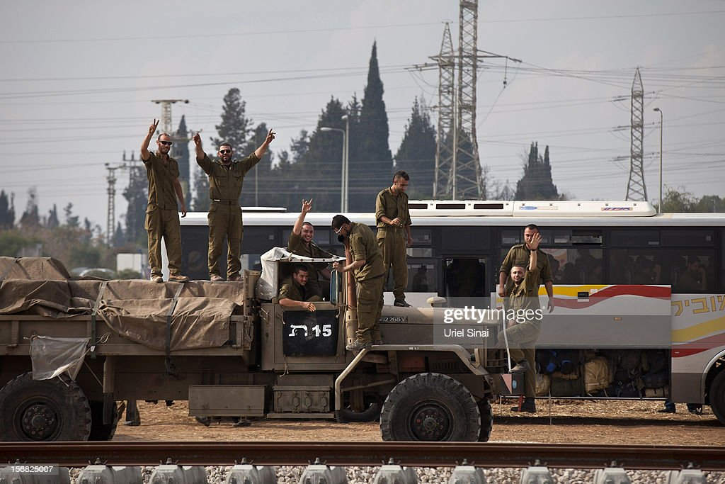 Israeli reserve soldiers leave the Gaza border area on November 22, 2012 near Israel's border with the Gaza Strip. The ceasefire between Israel and Hamas appears to be holding despite rockets being fired from Gaza. During the night the IDF reportedly arrested a number of 'terror operatives' in the West Bank in continued efforts to restore peace in the region.