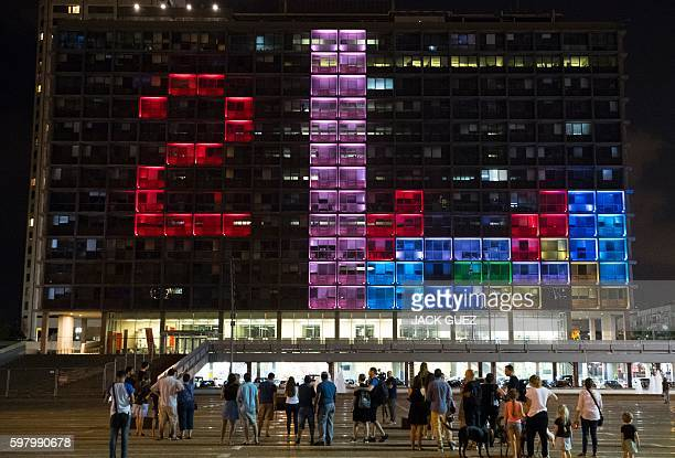 Israeli residents and foreign visitors compete in a giant Tetris tournament illuminating the windows of the facade of the Tel AvivYafo Municipality...
