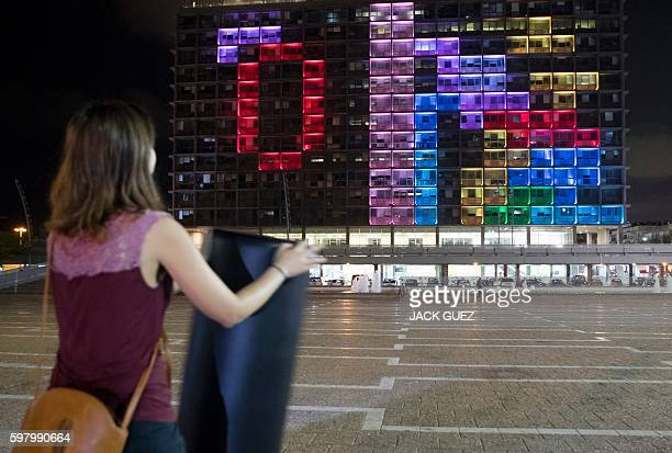 Israeli residents compete against foreign visitors in a giant Tetris tournament illuminating the windows of the facade of the Tel AvivYafo...