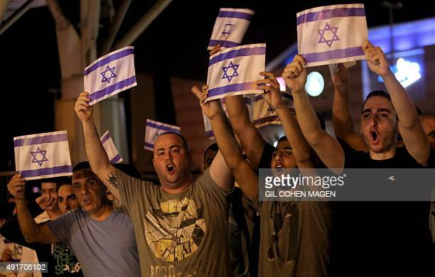 Israeli right wing activists protest at the site where a Palestinian carried out a stabbing attack in the Israeli city of Petah Tikva near Tel Aviv...