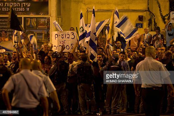 Israeli right wing activists protest in front of Israeli Arabs that protest against the Israeli attack on Gaza at the northern Israeli city of Haifa...
