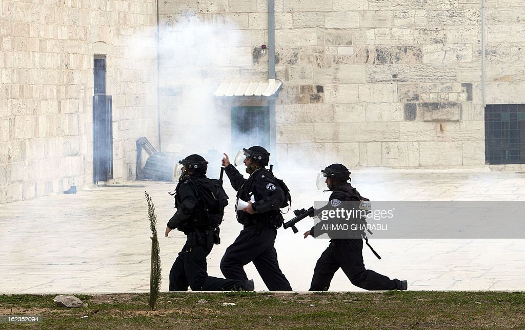 Israeli riot police are deployed at Jerusalem's Al-Aqsa mosque during clashes with Palestinian demonstrators gathering in solidarity with hunger-striking Palestinian prisoners on February 22, 2013. Palestinians demanding the release of hunger-striking prisoners clashed with Israelis in the West Bank and east Jerusalem, as three fasting inmates were taken to hospitals. AFP PHOTO/AHMAD GHARABLI