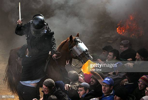 Israeli riot police clash with Israeli settlers February 1 2006 in the West Bank outpost of Amona The residents of Amona compose one of eightyseven...