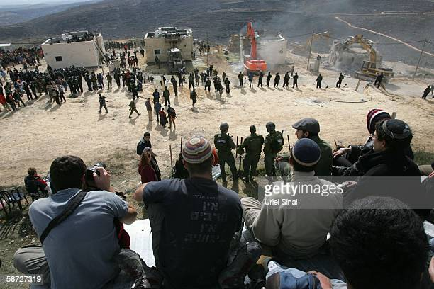 Israeli riot police cordon off from settlers demolition of houses February 1 2006 in the West Bank outpost of Amona The eighty residents of Amona...