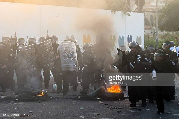 Israeli riot police secure a street during clashes with Palestinian protesters in the Arab Israeli city of Ar'Ara north of Israel on July 5 2014 A...