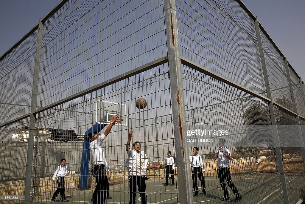 Israeli school children play basketball in Ramat Shlomo, a Jewish settlement in the mainly Palestinian eastern sector of Jerusalem, on October 30, 2013. Israel freed 26 veteran Palestinian prisoners overnight in line with commitments to the US-backed peace process, but moved in tandem to ramp up settlement in annexed east Jerusalem.