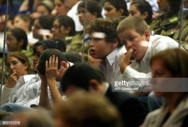 Israeli school children sit behind protected glass in the visitor's gallery of the Knesset in Jerusalem as they listen to the speech by Prime...