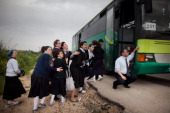 Israeli school girls take cover next to a bus during a rocket attack from the nearby Gaza Strip on March 12 2012 in Ashdod Israel The UN and EU have...