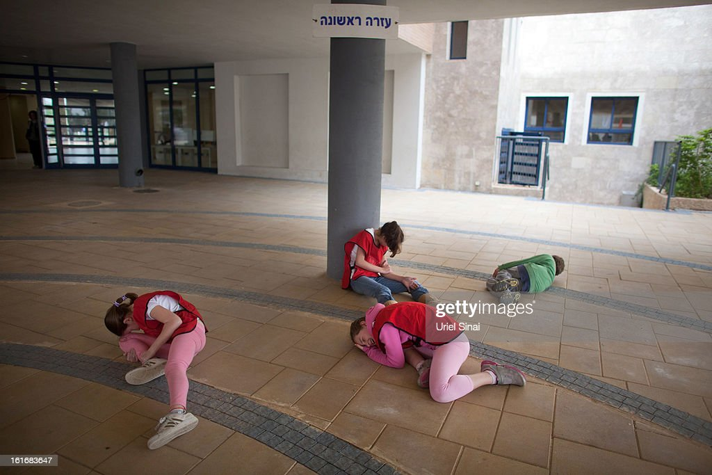 Israeli schoolchildren act as the wounded during a Home Front command drill simulating a rocket hitting a school on February 14, 2013 in Ra'anana, Israel. Working with the schools and emergency services, local authorities want to increase readiness for possible future attacks.