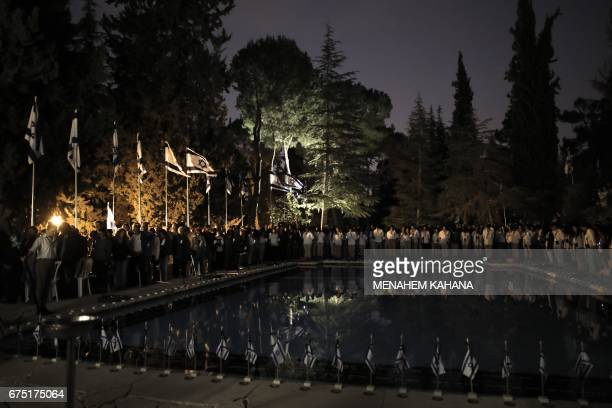 Israeli scouts observe a minute of silence during a ceremony at the Mount Herzel military cemetery in Jerusalem on April 30 at the start of...