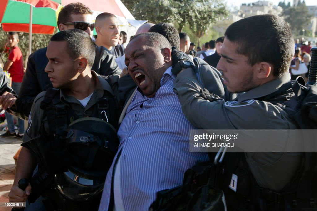 Israeli security arrest a Palestinian man as clashes broke out following the death of a Palestinian prisoner being held in an Israeli jail on April 2, 2013, at the entrance of Jerusalem's Old City next to the Damascus Gate. The Palestinian leadership blamed Israel for the death of Maisara Abu Hamdiyeh, a long-term prisoner with cancer, hiking tensions over a tinderbox issue closely followed on the Palestinian street.
