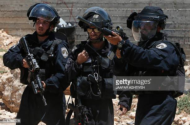 Israeli security forces aim looks towards Palestinian protestors during clashes following the weekly demonstration against the expropriation of...